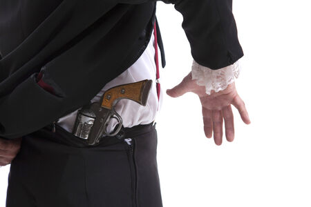 concealed: man in a suit holding a gun behind his back,isolated on white background