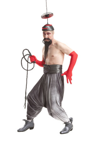 perversion: man in a costume for Halloween with a whip on white background