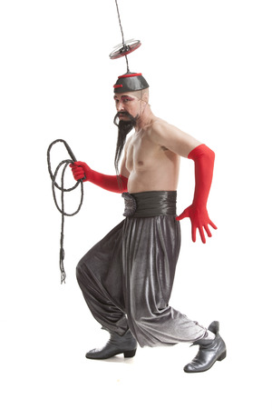 man in a costume for Halloween with a whip on white background