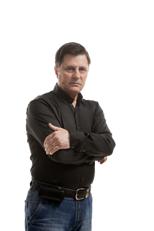 middle aged man in jeans and shirt Standard-Bild