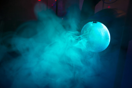 stage colored lights on a console, smoke Banco de Imagens