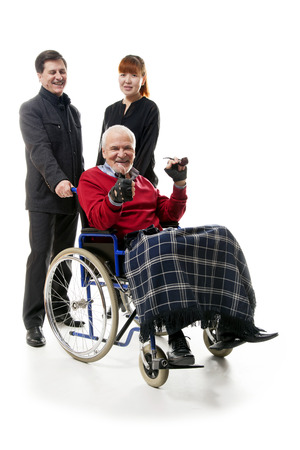 younger man: old man on wheelchair with younger man and woman