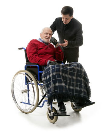 mobility nursing: old man in wheelchair with younger man