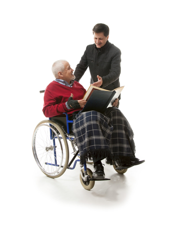 younger man: old man in wheelchair with younger man