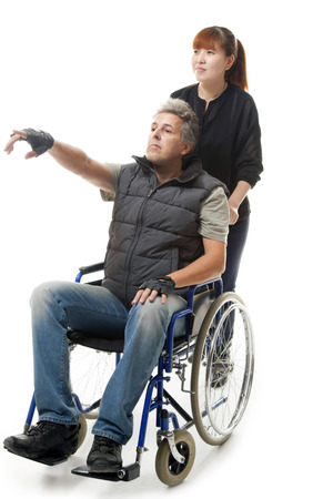 nursing sister: man on wheelchair with asian woman helping him