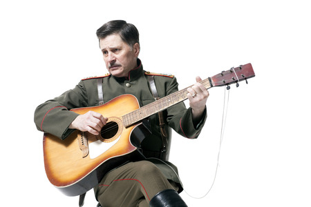 russian officer playing guitar isolated on white