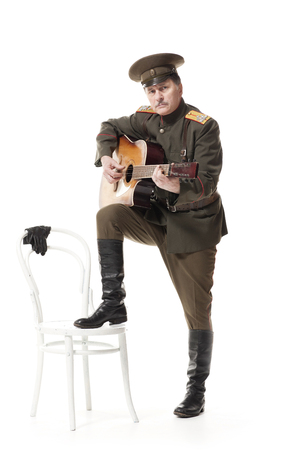 war decoration: russian officer playing guitar isolated on white