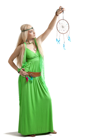 eye catcher: young sexy woman posing with dream catcher Stock Photo