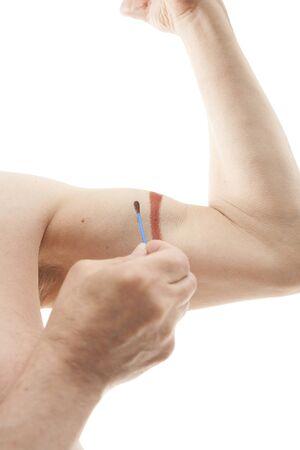 iodine: male hand applying iodine isolated on white
