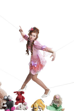 baby toys: Pretty woman in pink baby doll dress playing with toys