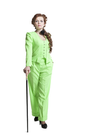 european ethnicity: Pretty woman in Retro style costume with walking stick