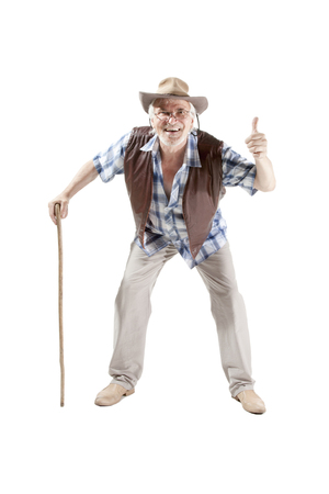 impair: Full length portrait of a senior man walking with cane  giving thumbs up isolated on white background