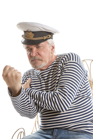 grizzled: Portrait of old sailor man in striped shirt and hat isolated on white background