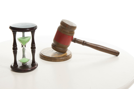 Judge  hammering and sand hourglass on the table