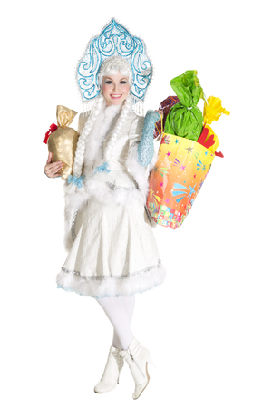 snegurochka: Girl dressed in traditional russian christmas costume of Snegurochka (Snow Maiden), isolated on white background with gifts Stock Photo
