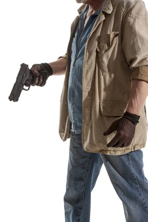Man in black gloves with a gun in hand isolated on white background