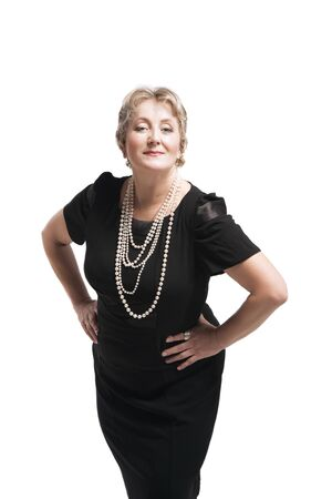 Attractive happy middle-aged woman in black dress