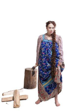 stockpile: portrait of woman dancing in russian folk dress chopping and splitting wood isolated on white background Stock Photo