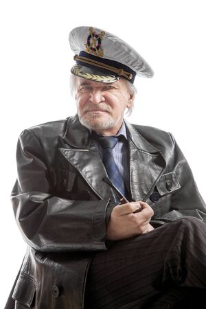 white headed: Portrait of old sailor man in  hat  with pipe  on white background Stock Photo
