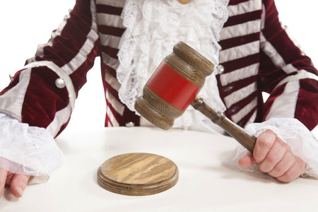 proceeding: judge declares the legal proceeding with a final hit using the gavel Stock Photo