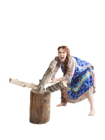 splitting: portrait of woman dancing in russian folk dress chopping and splitting wood isolated on white background Stock Photo