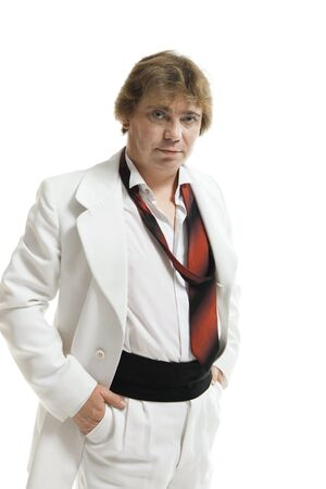 unleashed: middle-aged man in a white suit with unleashed  tie