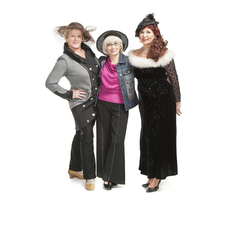 beautiful  home: Three adult ladies in original clothes in the studio for a photo shoot.