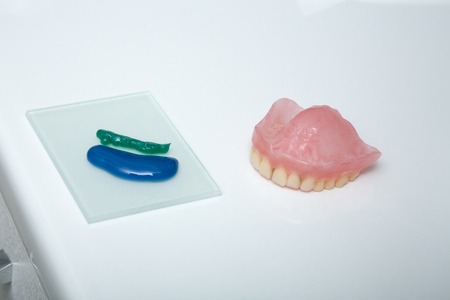 resurfacing: Repair and resurfacing the top of the jaw of a removable denture