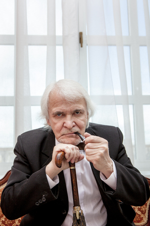 demanding: The Director-General is strict and demanding in a smart suit Stock Photo