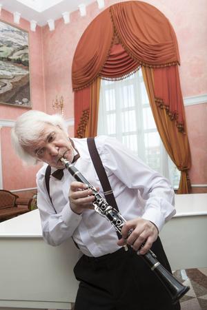 clarinet: Vigorous charming aging musician plays the clarinet