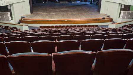 Empty rows of blue chairs in the auditorium of the theater Stock Photo
