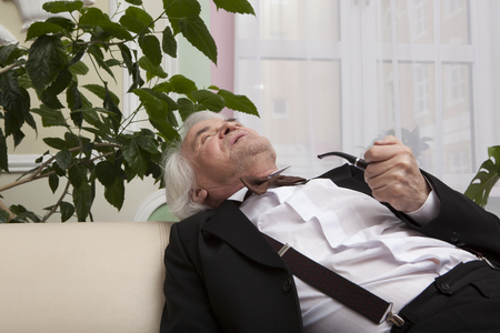 winter garden: businessman is resting in a tuxedo in the winter garden Stock Photo