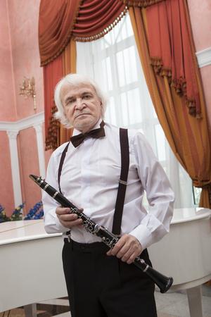 vigorous: Vigorous charming aging musician plays the clarinet