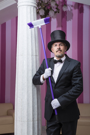 frock coat: Servant in a frock coat and top hat engaged in cleaning expo hall