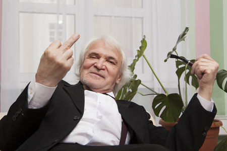 businessman is resting in a tuxedo in the winter garden Stock Photo