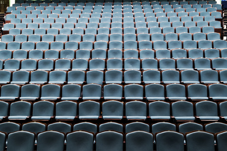 Empty rows of blue chairs in the auditorium of the theater Banco de Imagens
