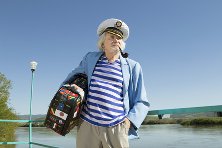 Captain in the tourist travel. Pending the ship at the pier