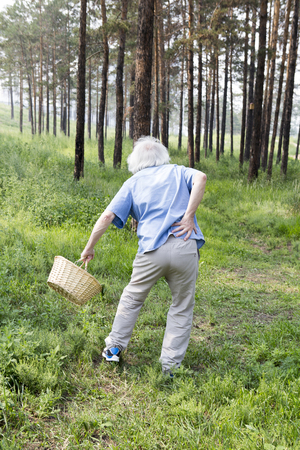 walk in: On a walk in the park elderly man with back pain. A sudden bout of back pain.