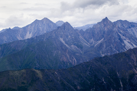 tunka range: View of the mountains of the Tunkinsky National Park in the Republic of Buryatia of the Russian Federation from the cockpit of the helicopter. The name of the mountain range -  Eastern Sayans. Stock Photo