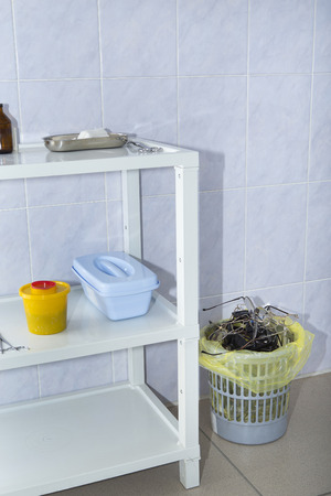 The cured patient of the ophthalmologist throws away unnecessary glasses in the garbage container after the operation for restoring vision. Stock fotó