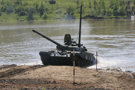 Chita, Zabaikalsky Krai, Russia, 06152005. Training ground in Eastern Siberia. Military exercises of the tank brigade in a situation close to the combat situation. Forcing a water obstacle. Shooting on the meshes.