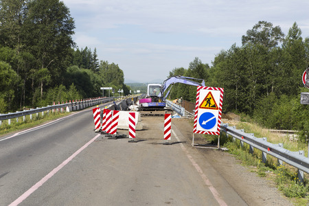 Support activities for the construction of roads and highways. The road is under construction and repair. Stock Photo