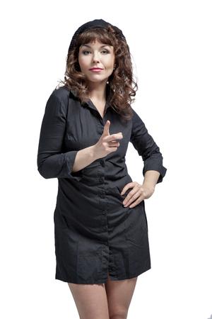 Young woman in mini dress with beautiful legs dancing and posing in studio