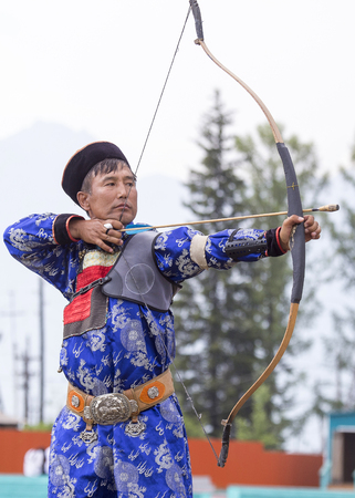 Competitions in shooting from a sports bow in Siberia. Mongolian competitions in archery. 写真素材