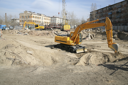 Preparation of the site for the beginning of construction, removal of garbage from the demolished building, geodetic work Stock Photo