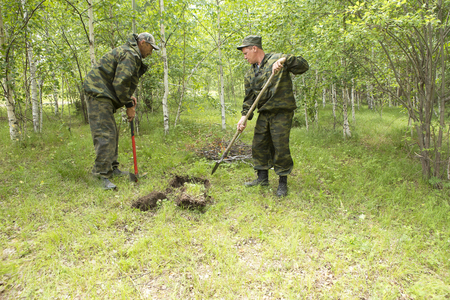 Forest firefighters conduct exercises to prevent a fire in the forest. Firemen put out fire in the forest. Firefighters close the ground where the fire in the forest was burning.