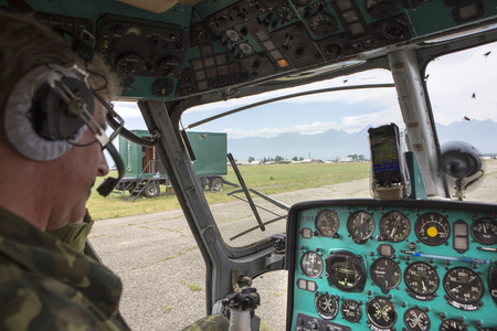 Kyren, Russia, Republic of Buryatia - July 01, 1917. The flight of the helicopter MI 2. Type of cockpit and instrument panel.