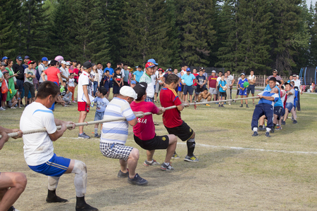 Russia, Republic of Buryatia, Kyren settlement - June 25, 1917: Sports games in eastern Siberia on the national holiday of the Buryat people Sukharban. Two opposing teams pull the rope. The team that pulls the opponent to his side wins.