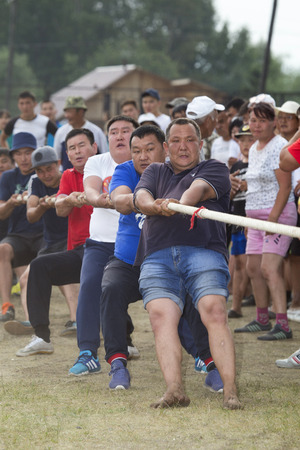 Russia, Republic of Buryatia, Kyren settlement - June 25, 1917: Sports games in eastern Siberia on the national holiday of the Buryat people Sukharban. Two opposing teams pull the rope. The team that