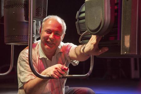 Lighting designer sets theatrical light before the performance